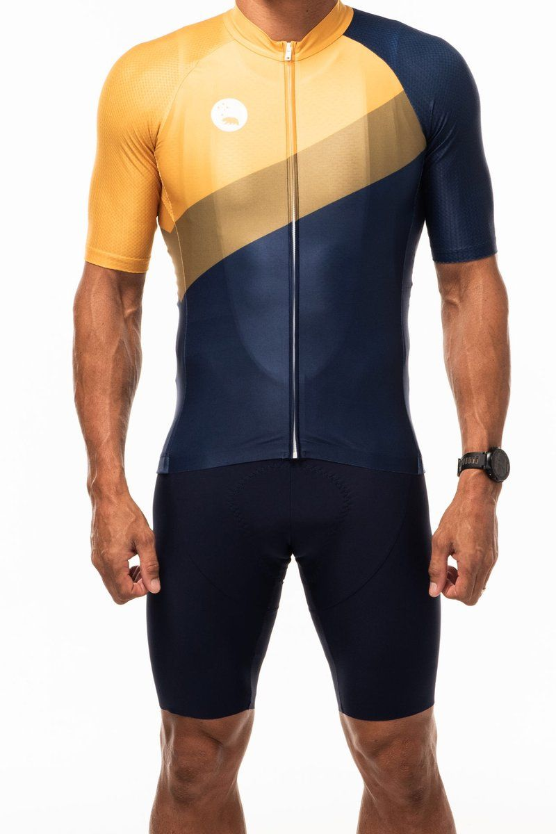 The Stelvio Colorway Combines Regal Navy With Modish Mustard And Gold Be Seen On The Roads But Be Seen Cycling Jersey Design Cycling Outfit Cycling Jersey