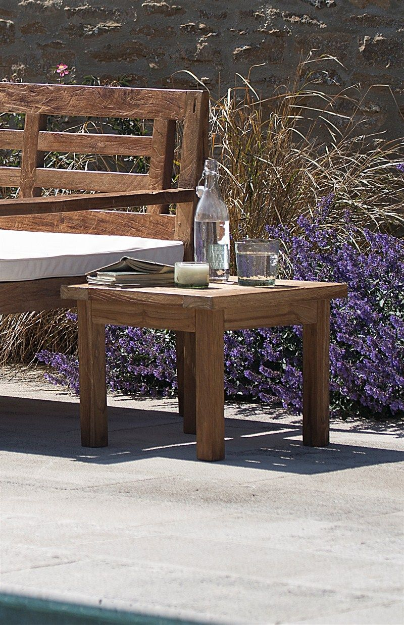 A Stylish And Durable Outside Table Crafted In Reclaimed Teak