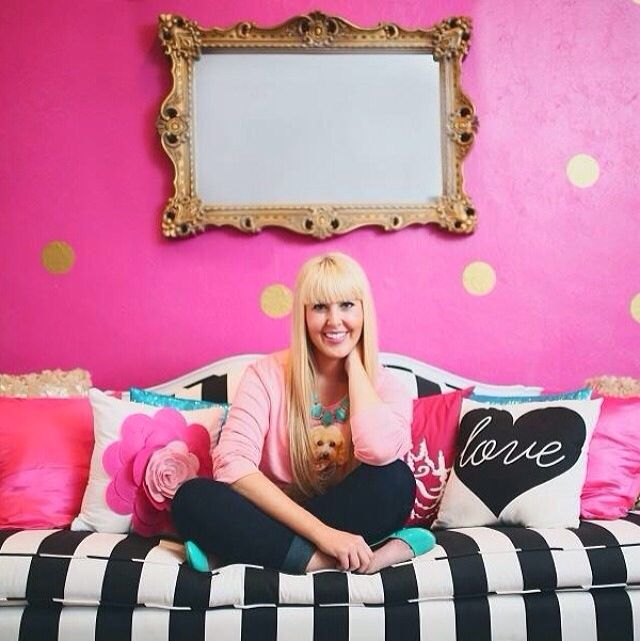Pink wall with gold polka dots and black and white striped sofa ...