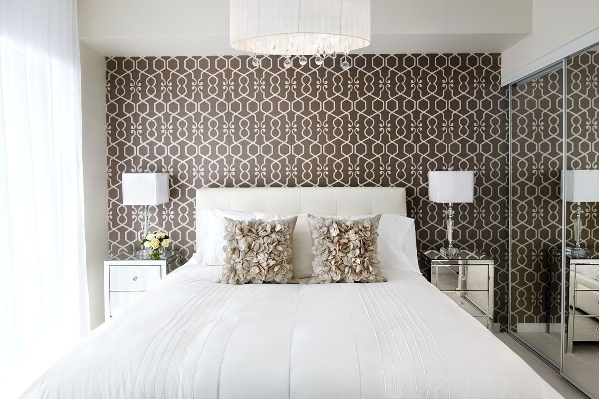 Wallpaper certainly rejuvenates this standard bedroom Lisa Petrole