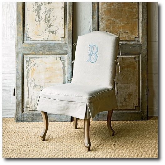 Embroidered monogramed chair slipcover designed by Betty Burgess