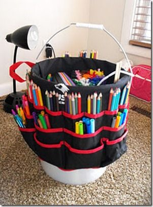 Buy a Bucket Boss (a portable tool belt that hooks on a bucket) from a building supply store for about $7, put it on a bucket (duh), and add the kids' art supplies & small games. Inside holds big stuff like paper and all the pockets on the outside are for pens, markers, glue, scissors, small games, etc...PERFECT for homework!!