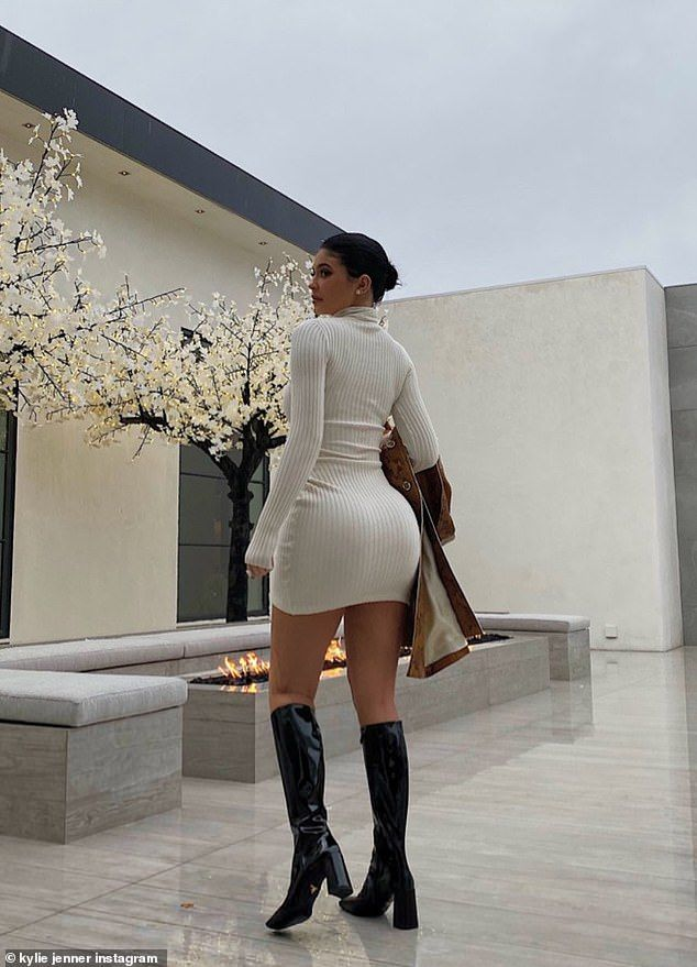 Kylie flashes her killer curves in form-fitting dr
