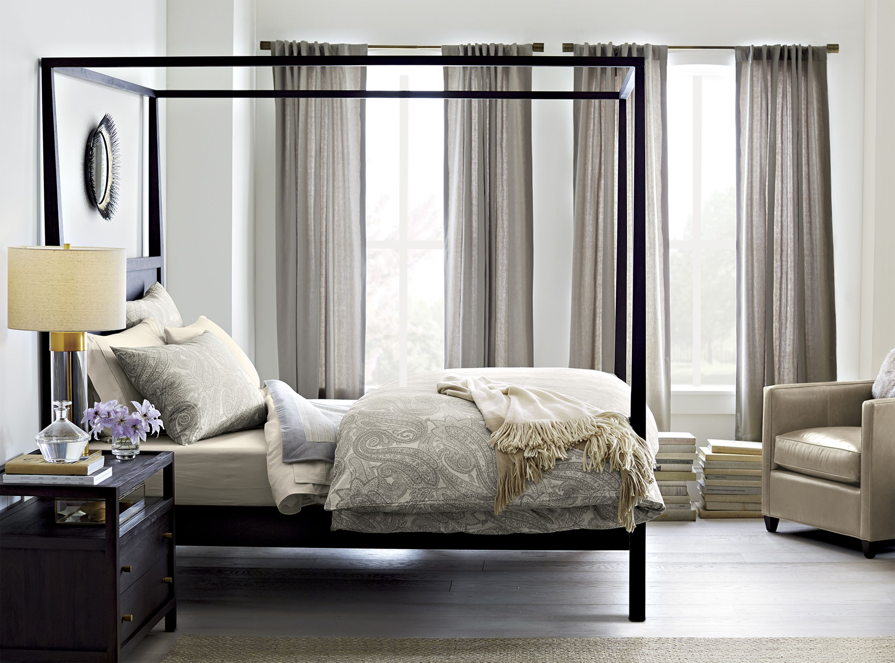 Keane streamlines the traditional canopy bed into an open airy cube of beautiful mahogany veneer