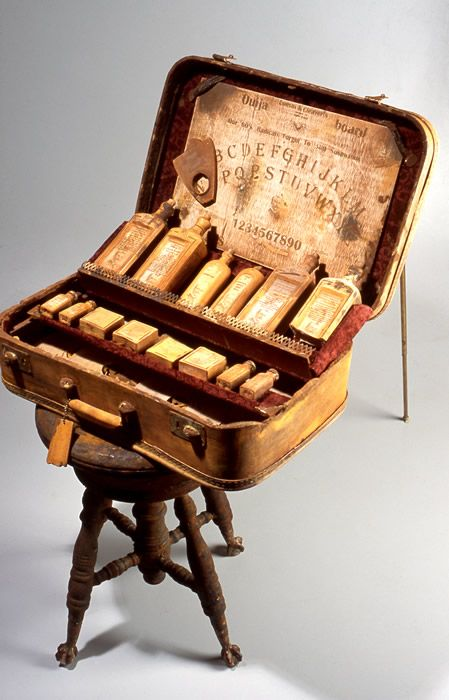 ouija. I really wonder what all the bottles are for. Maybe potions to help fix your fortunes after they were read to you.