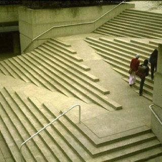 Stairs and wheelchair ramp incorporated into one space for Handicap stairs plans