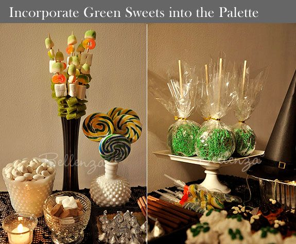 a playful halloween candy table with candy apples marshmallow skewers lollipops and so