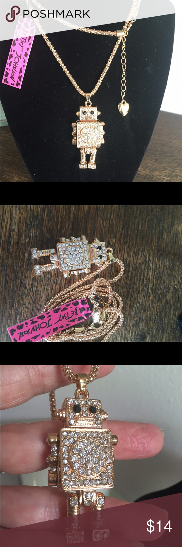 Cute robot necklace Goldtone robot with clear crystals on this cute necklace.  The legs & arms move back & forth. Betsey Johnson Jewelry Necklaces
