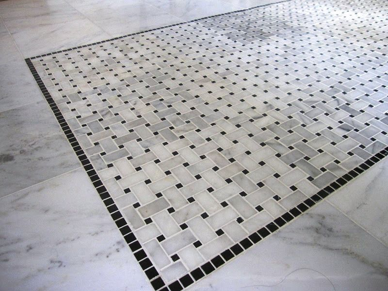 Detail of marble basketweave black and white tile on the master ...