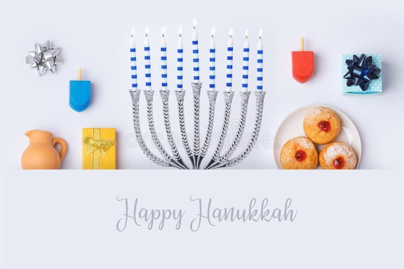 Jewish holiday Hanukkah banner design with menorah Sufganiyot and spinning top