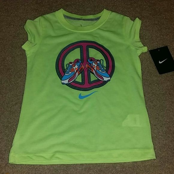 Nike girls sz 6X shirt NWT New with tag.  Polyester.   Volt ice.  Please check my other listings.   Thank you for looking and have a great day! Nike Tops