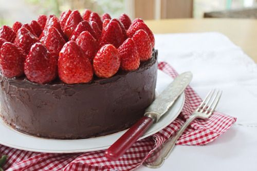 Beautiful Triple Layer Chocolate Cake Topped With Strawberries A