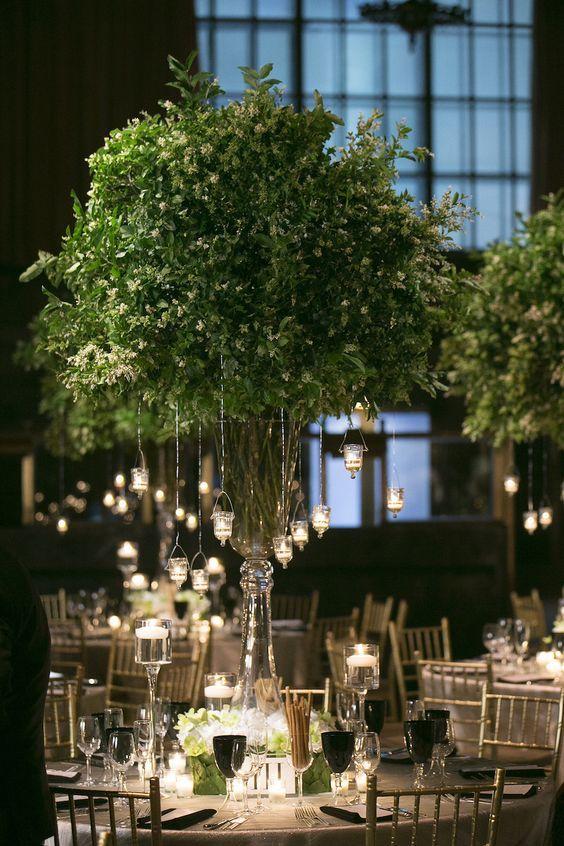 Lush Greenery & Candle Centerpiece  Photography: Brett Matthews Photography Read More: http://www.insideweddings.com/weddings/classic-greek-orthodox-ceremony-modern-reception-in-new-york-city/702/: