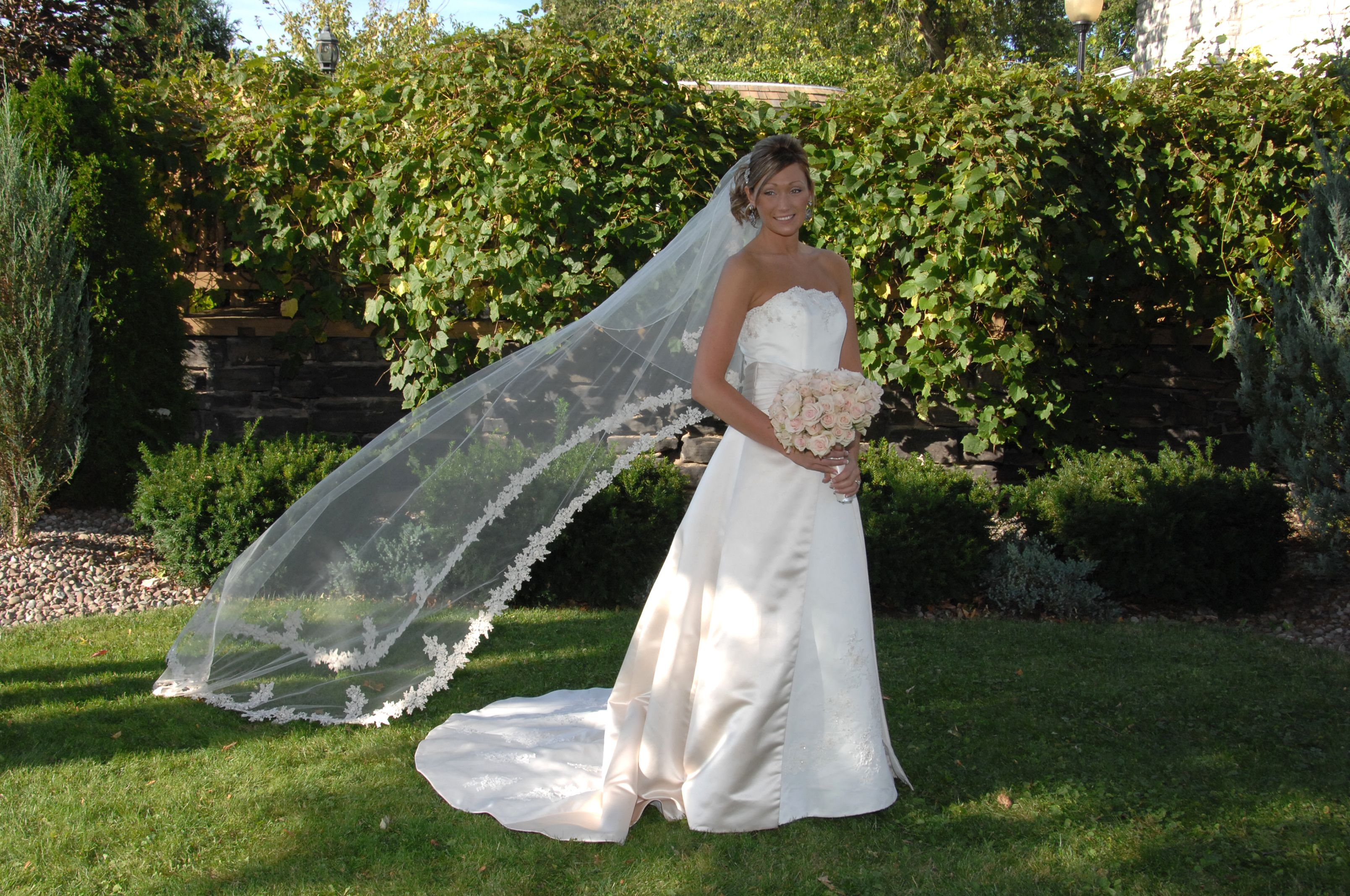 photograph of the bride with veil blowing