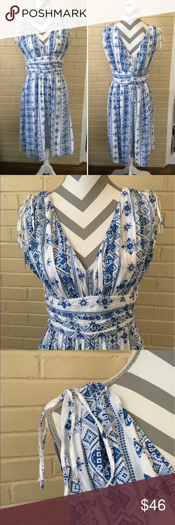 NWOT April May Blue White Cotton Floral Sundress L NWOT April, May for Anthropologie blue and white cotton sundress size ladies large. Sundress has ties at the shoulders and zips in the back with no lining. It is THE classic sundress ~ stunning and new without tags. Smoke free. MEASUREMENTS: underarm to underarm lying flat - 18 inches FLAT, waist lying flat is 16 inches and the length from top strap to bottom hem is 40 inches. Anthropologie Dresses Midi