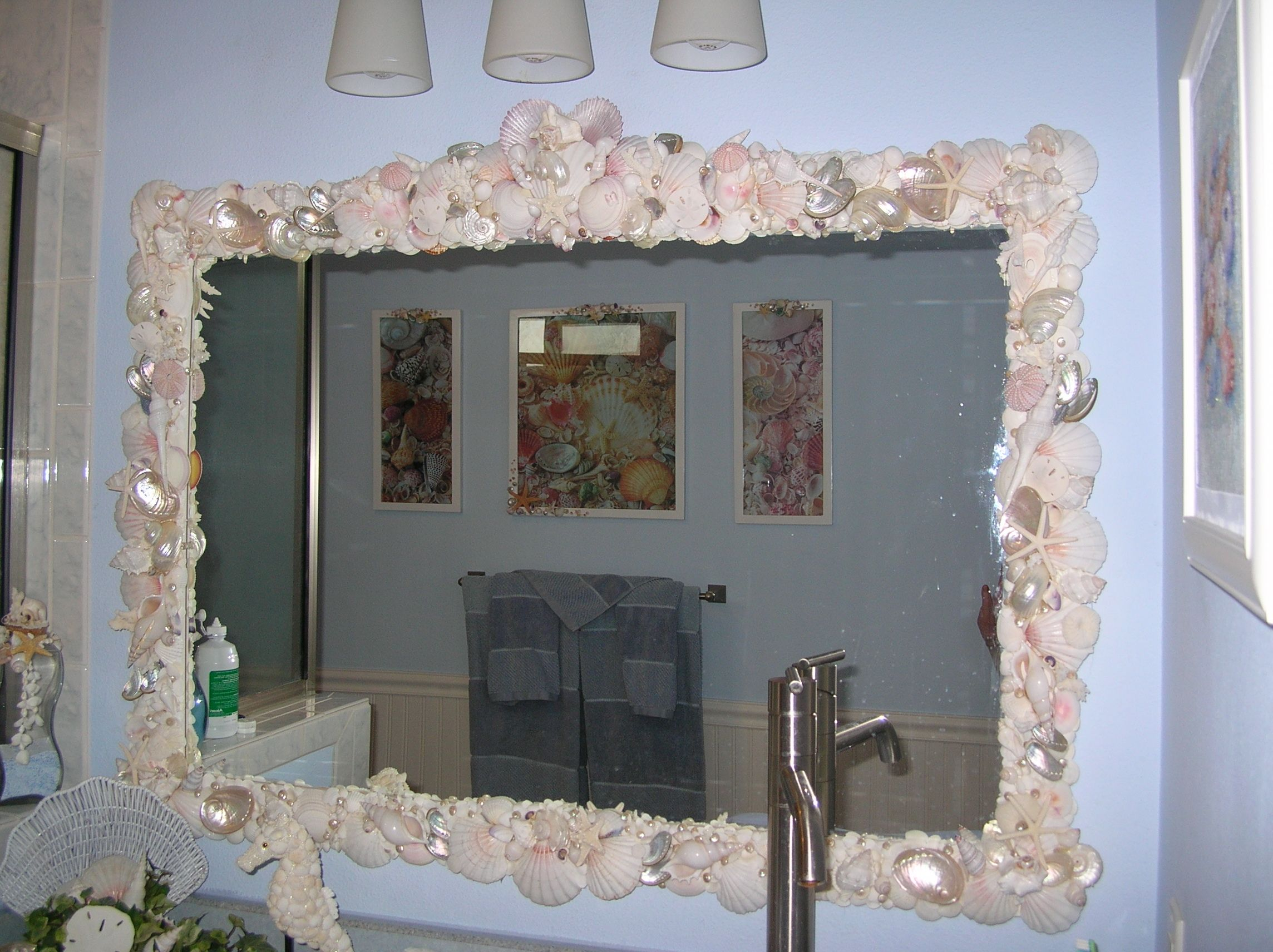 This mirror as over a thousand seashells on it Mostly white shells