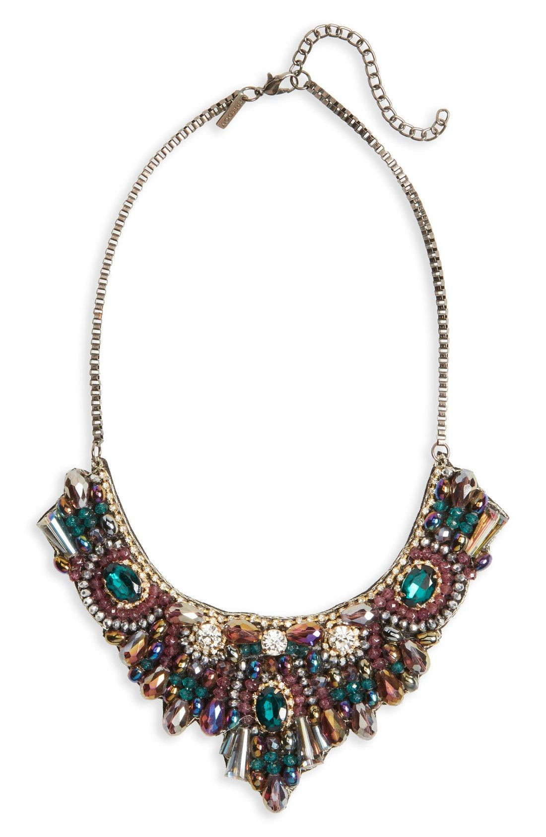 Preparing to get glam this party season with this stunning statement necklace featuring an array of multicolored beads and sparkling crystals.