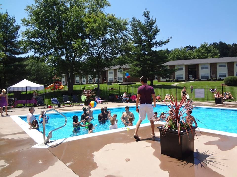 Playing Games With The Kids At The Summer Pool Party For