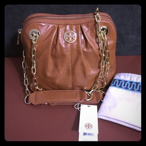 """Tory Burch Dena Mini Bag 100% Authenthic Brand New Tory Burch Dena Mini Bag, chain strap can be doubled or and carried as shoulder bag or single and carried as a crossbody bag. This bag is made of waxed  full grained genuine leather. The leather on Dena Mini is designed to have a slight vintage look. Interior: fabric lined w/ one zip pocket and one slip pocket, 8.5"""" H x 9"""" W x 5.5"""" D, 10.5"""" to 20"""" shoulder strap Tory Burch Bags Shoulder Bags"""