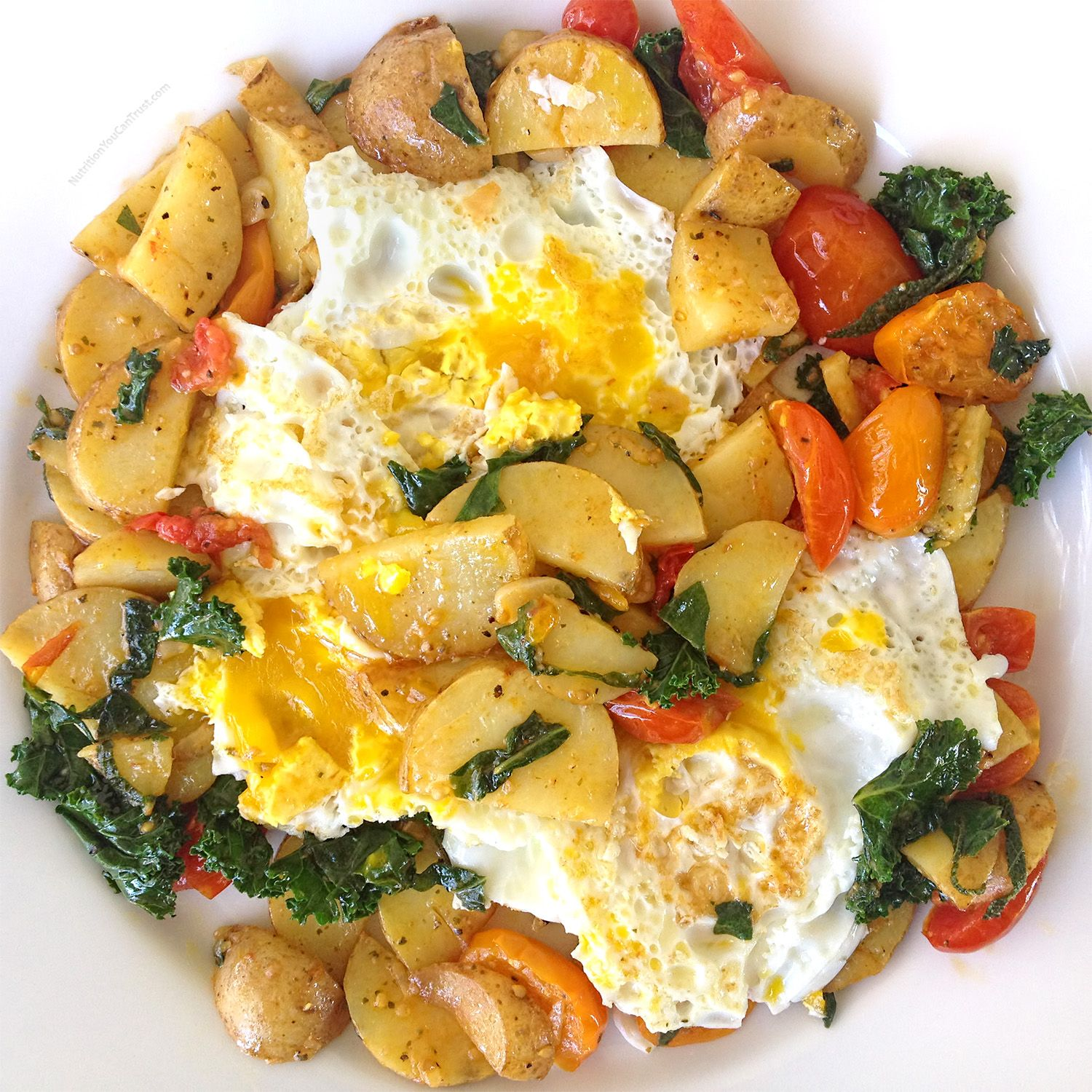 Veggie Hash consisting of potatoes, rainbow cherry tomatoes, #gardentotable kale & herbs and topped off with coconut oil fried #pastured eggs.  #local #organic #realfood #breakfast #inspo