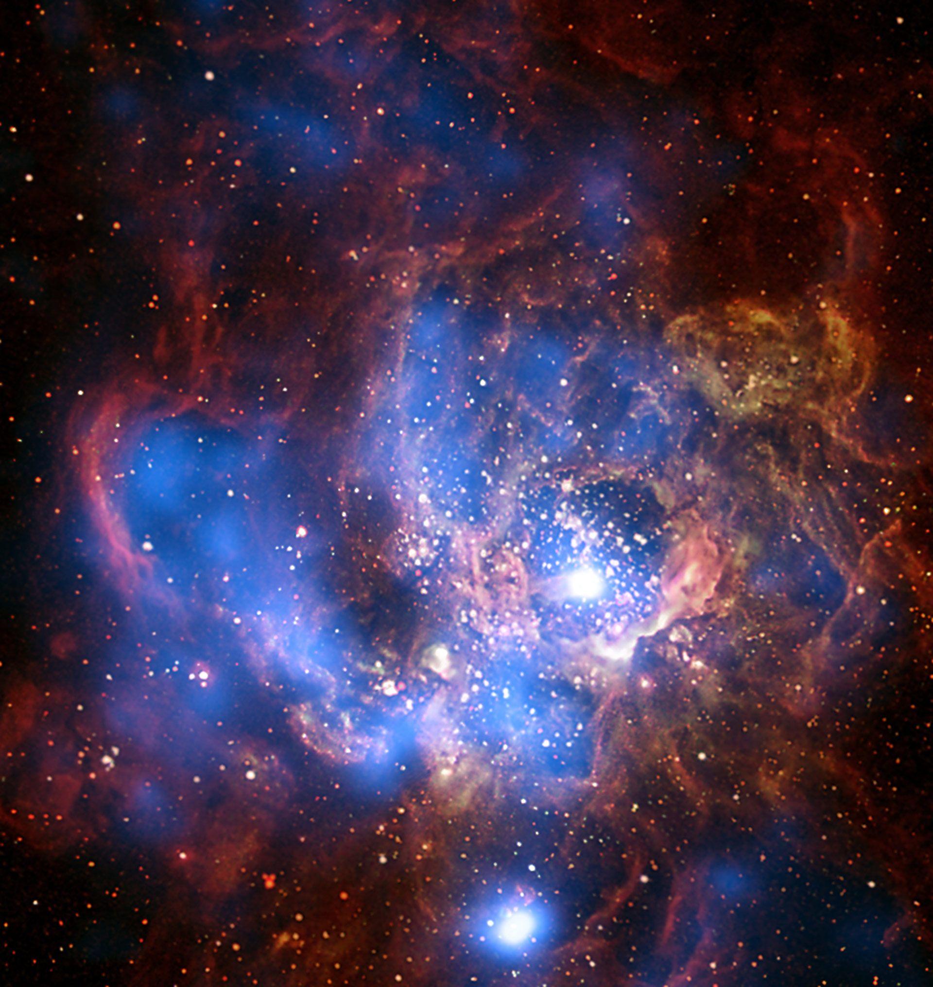 La formazione stellare della galassia NGC 694 come si è visto in X-ray (blu) e ottica. L'emissione di raggi X è dovuto in gran parte ai processi associati alla formazione stellare, e gli astronomi hanno capito come determinare il tasso di formazione stellare dal flusso di raggi X misurato. Raggi X