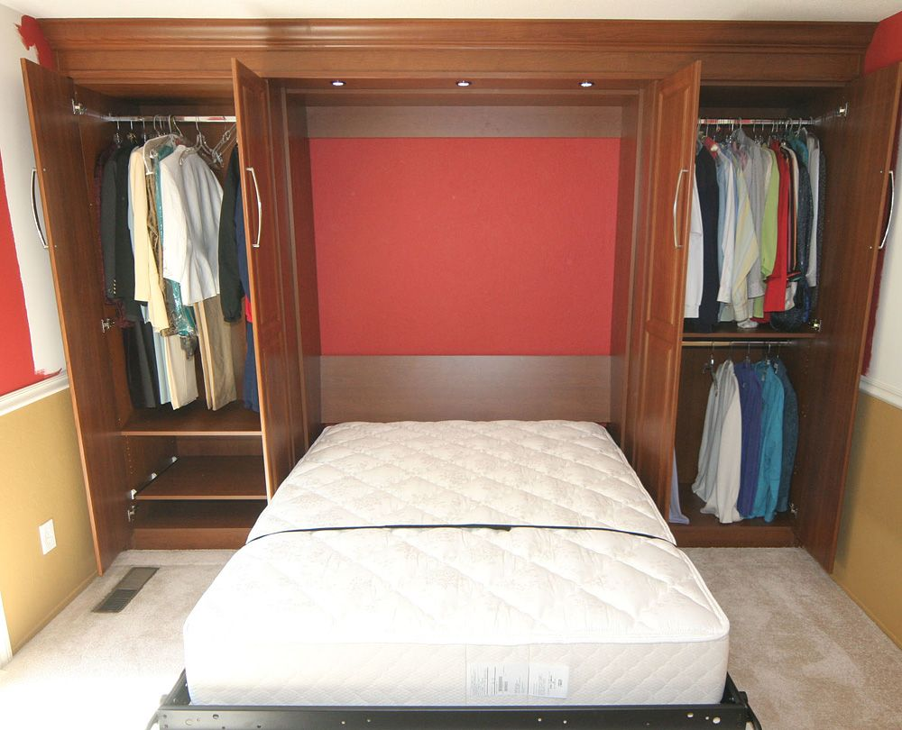 Clever Murphy bed setup with closet space. organize