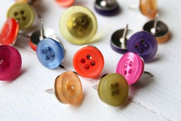 Great Idea for all those awesome buttons that I love to look at and collect!   Button Push Pins by When It Rains eclectic bulletin board