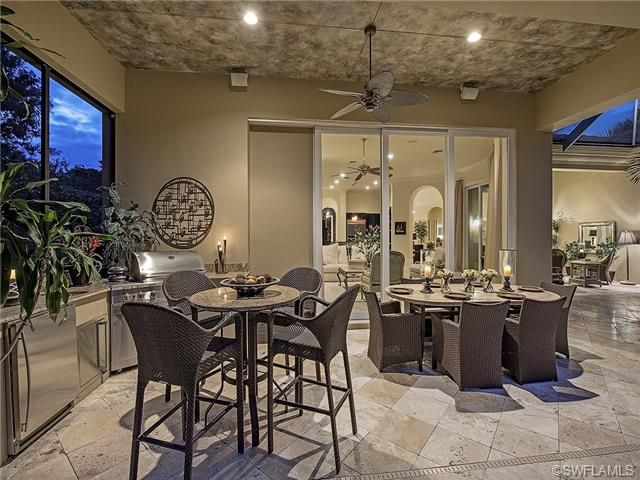 Outdoor Living Lanai Dining Summer Outdoor Kitchen Built In Grill Travertine Pavers Built In Grill Outdoor Kitchen Design Naples Homes For Sale