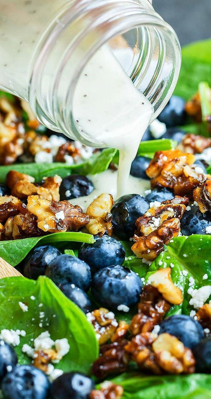 This Blueberry Spinach Salad is tossed with a homemade lemon poppy seed dressing that is crazy easy to make with just a few tasty ingredients We love ours topped with can...