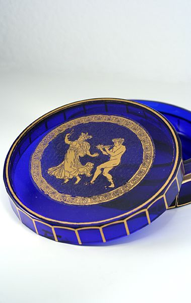 A most attractive cobalt glass circular box and cover with gilt highlighted facet sides. The lid is decorated in high detail with an acid cut Danse de