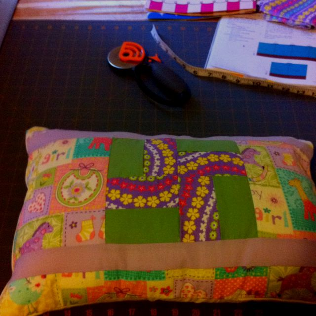 Pillow that matches the baby quilt I made for Angie.