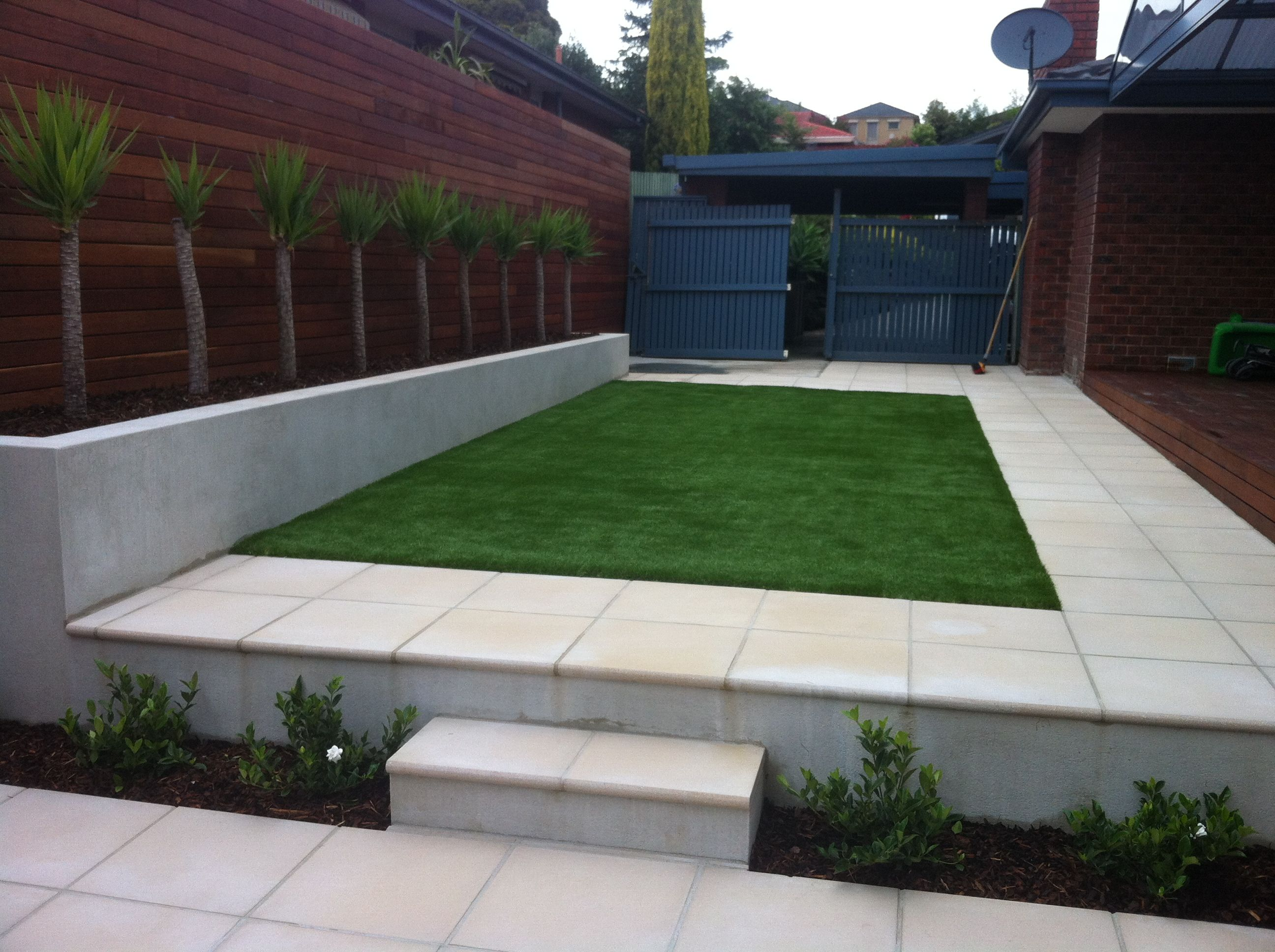 Artificial turf paving and a rendered wall templestowe for Rendered garden wall designs