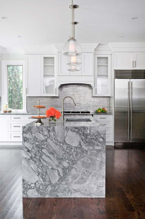 White Kitchen Cabinets Paired With Marble Countertops And Stainless Steel Linear Tile Back Marble Kitchen Island Grey Marble Kitchen Marble Countertops Kitchen