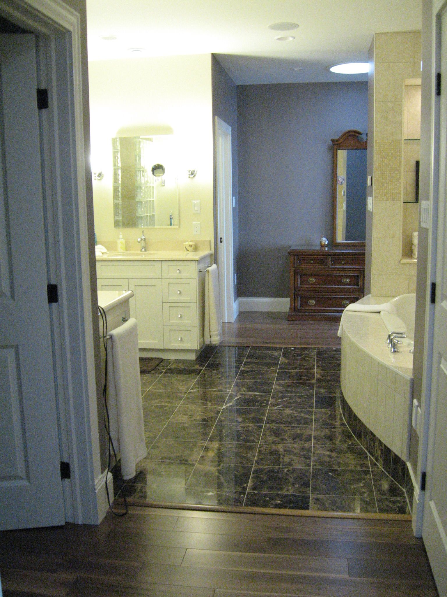 Marble walls and floor ensuite with two sided access