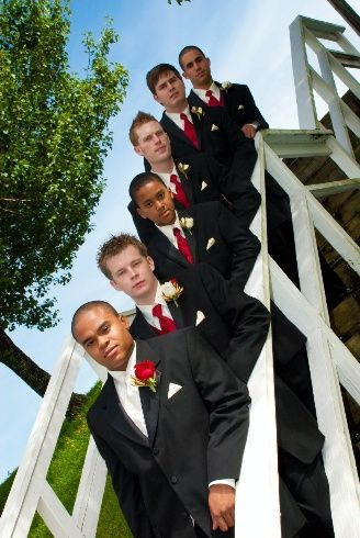 Amy,  Here's an example of the groom in white and all the groomsmen in color.