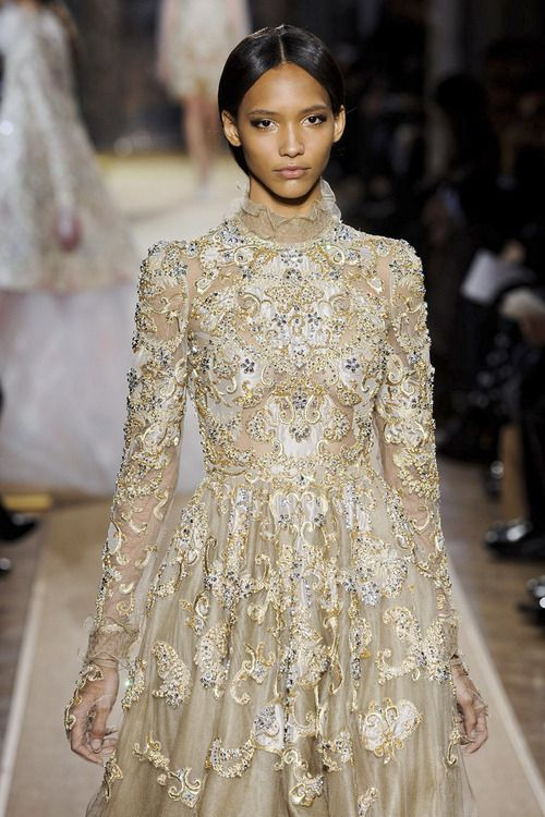 Wined eyes and natural lips on Cora Emmanuel at Valentino Haute Couture...