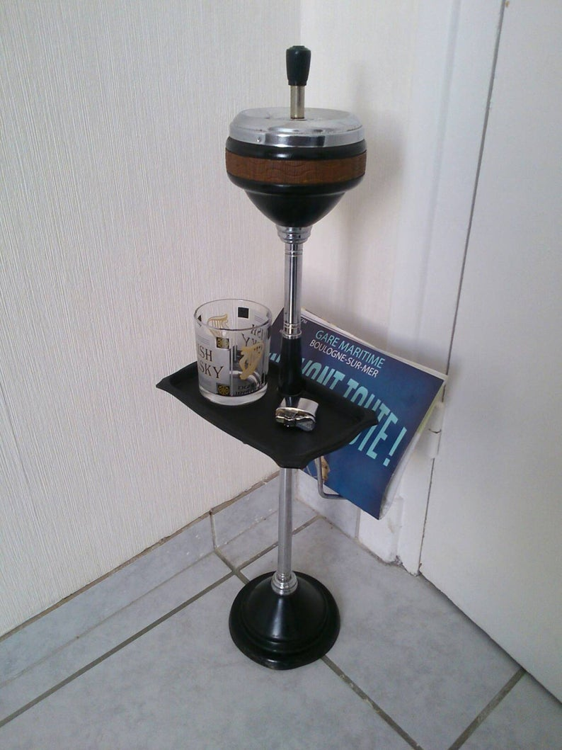 Standing ashtray with magazine door and vintage tablet