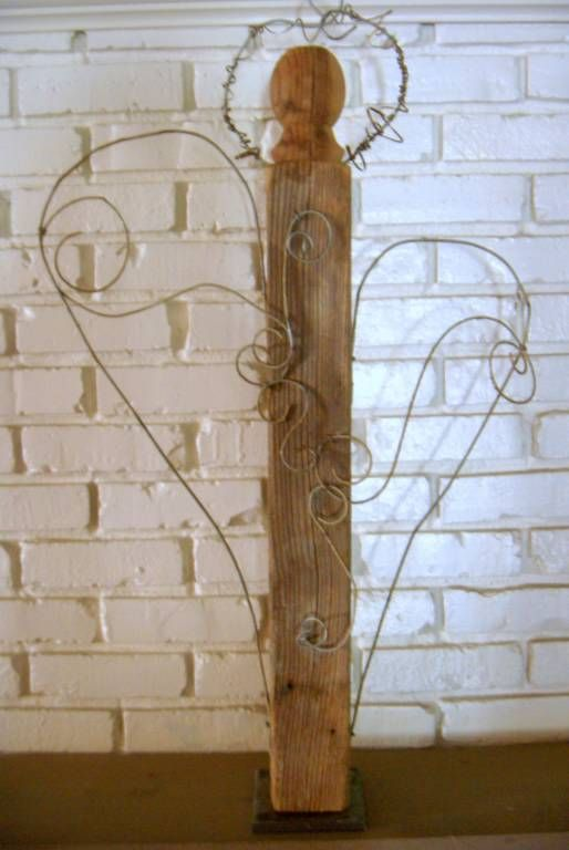 Upcycled bedpost angel with wispy wire wings and halo and necklace made with wire and bolts!  now at Brookwood Community!