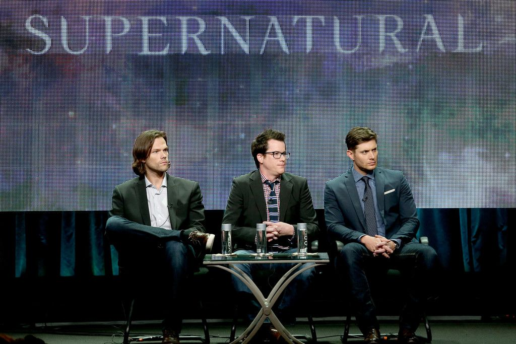 """(L-R) Actor Jared Padalecki, producer Jeremy Carver, and actor Jensen Ackles speak onstage at the """"Supernatural"""" panel during the El Rey Network portion of the 2014 Summer Television Critics Association at The Beverly Hilton Hotel on July 18, 2014 in Beverly Hills, California."""