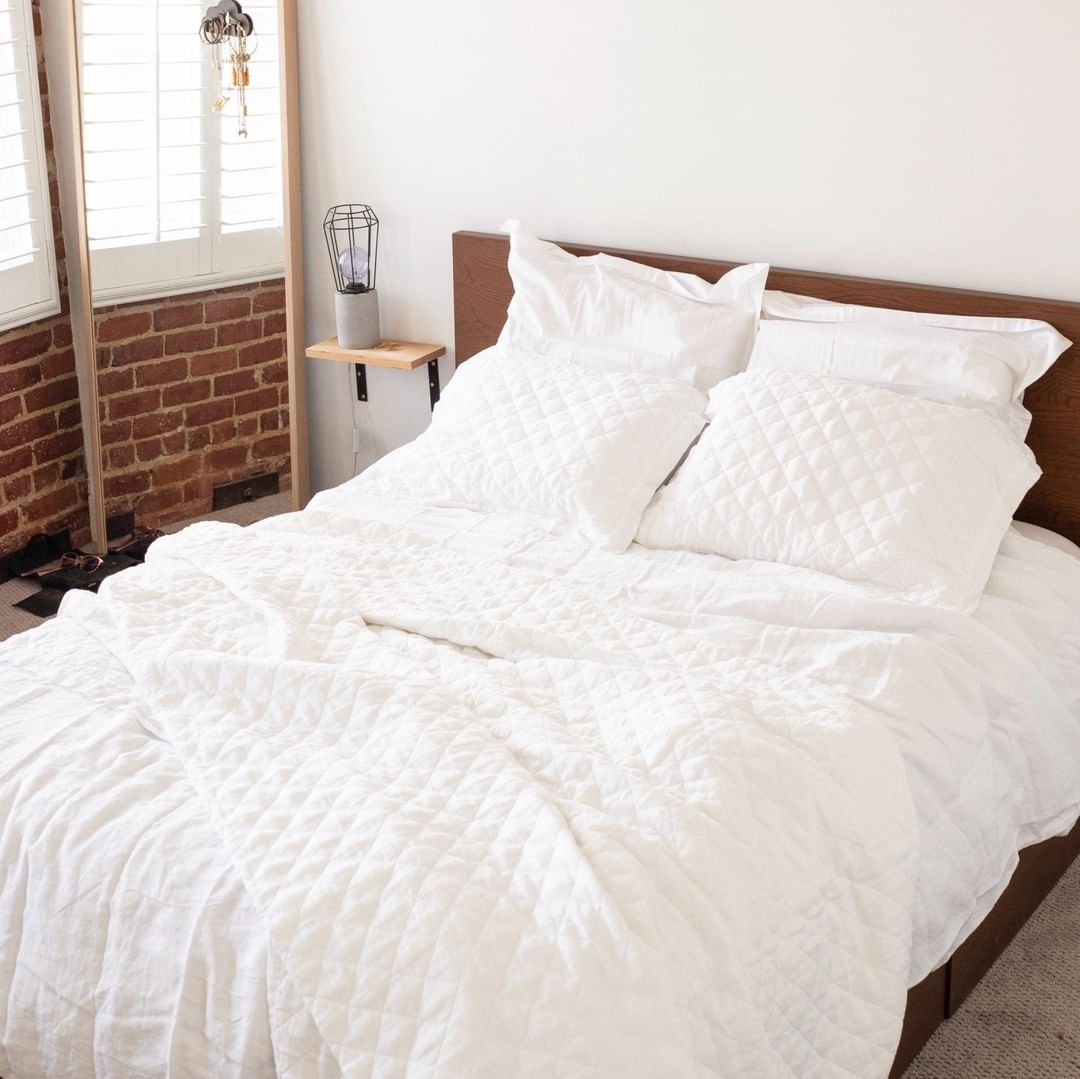 The Perfectly Unmade Bed Pro Tip To Prevent An All White Bed