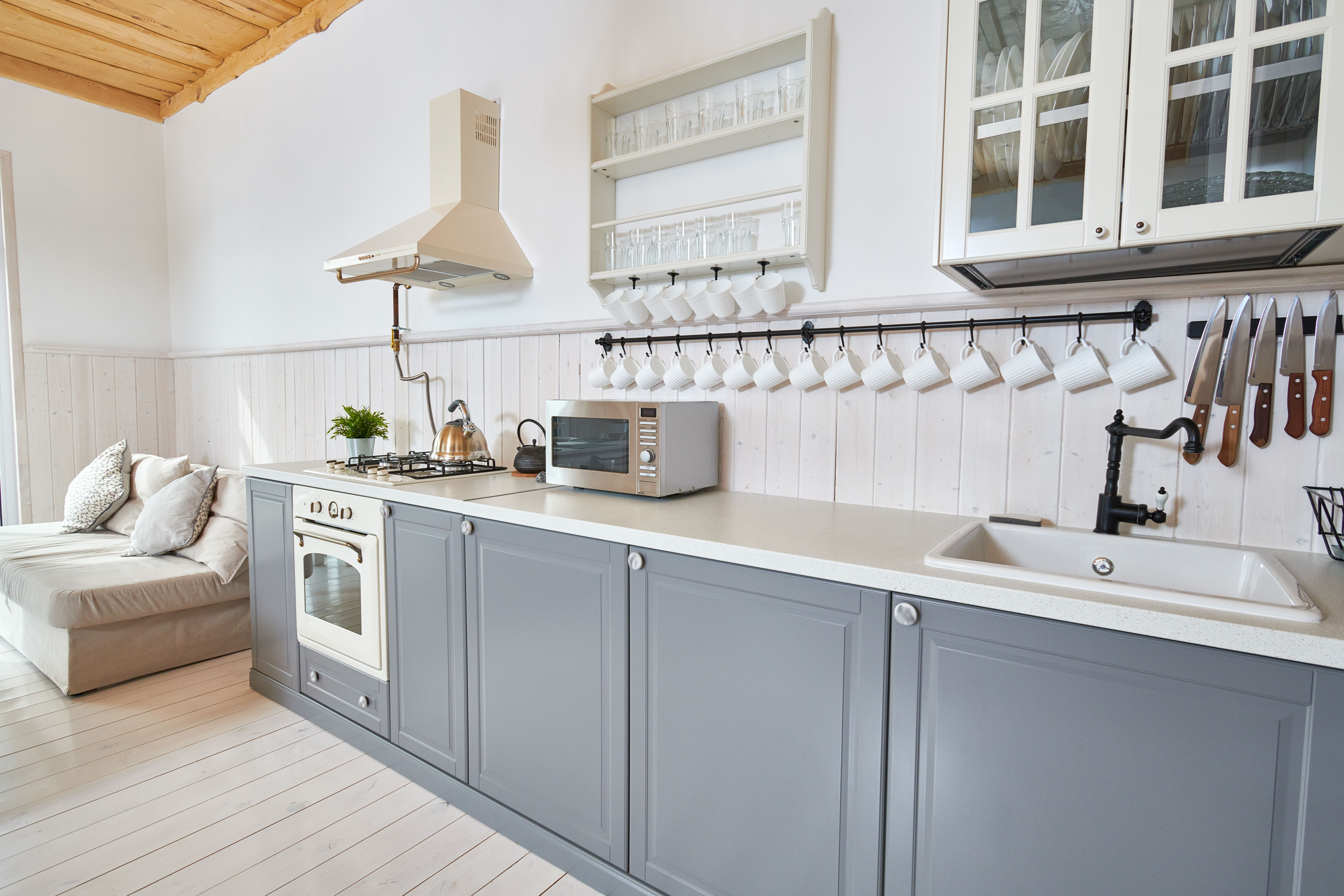 How to Spray-Paint Kitchen Cabinets | Spray paint kitchen ...