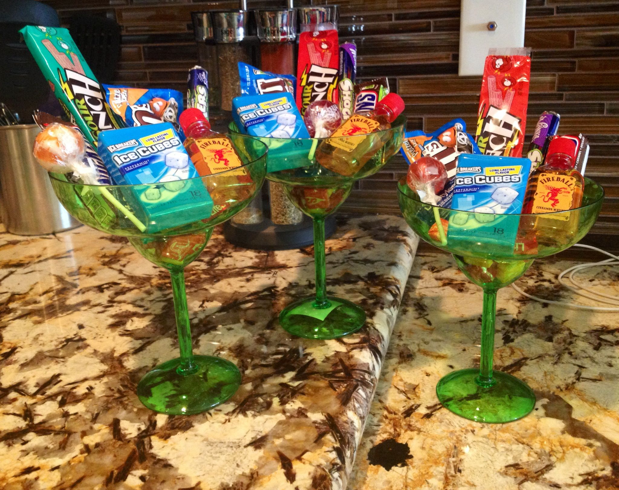 Margarita glasses filled with goodies for football bingo prizes ...