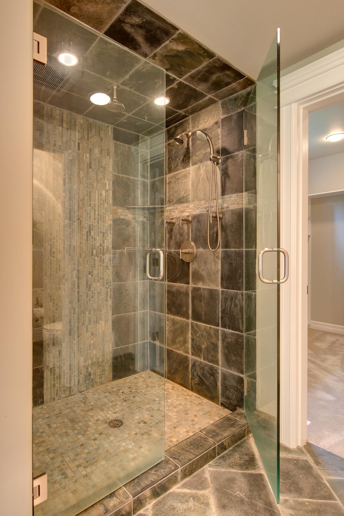bathroom monumental mosaic bathroom tiles ideas with unique design for the shower tray and as accent on the shower wall also large natural stone tiles for