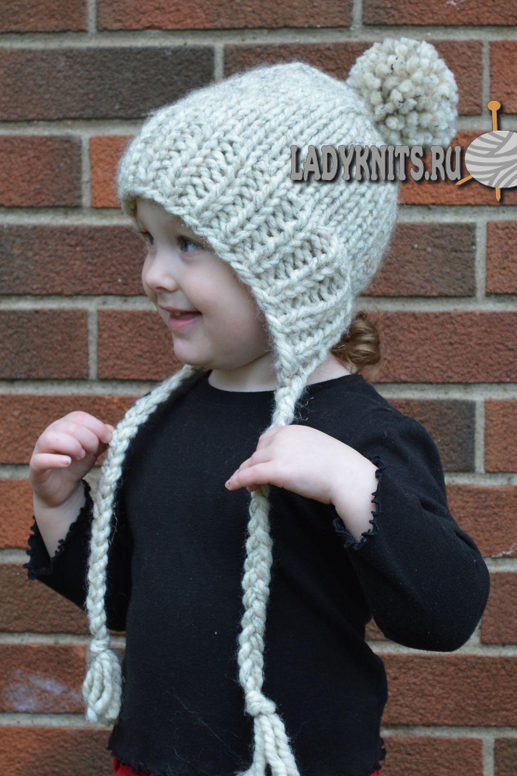 вязаная спицами теплая детская шапочка с завязками вязание