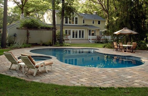 Pool Patio With Pavers | ... Pool Is Surrounded By A Paver Deck.