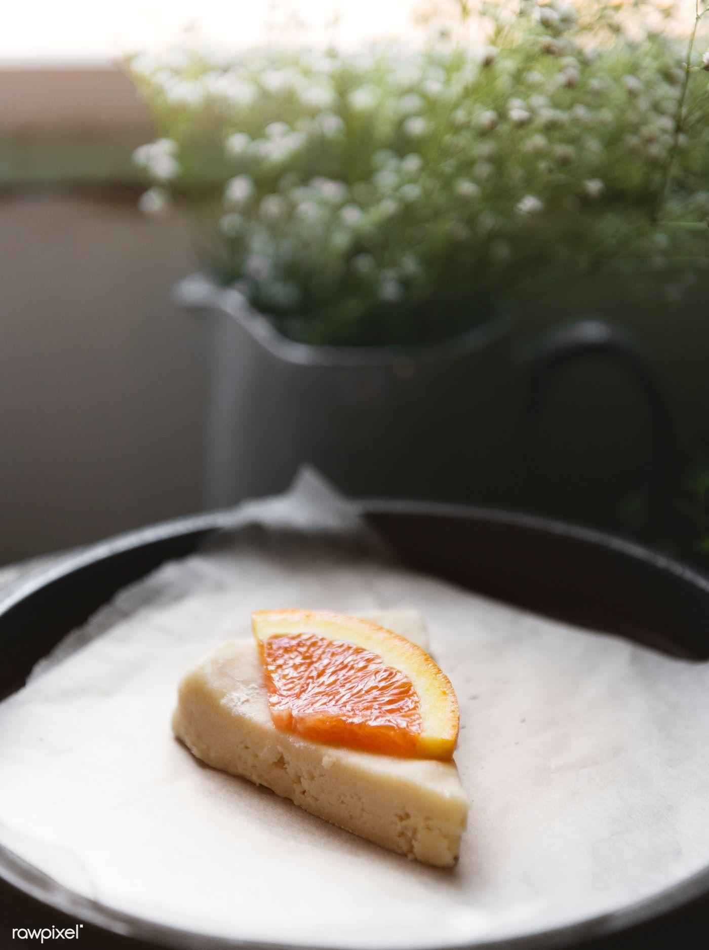 Download premium photo of Homemade scones with orange jam