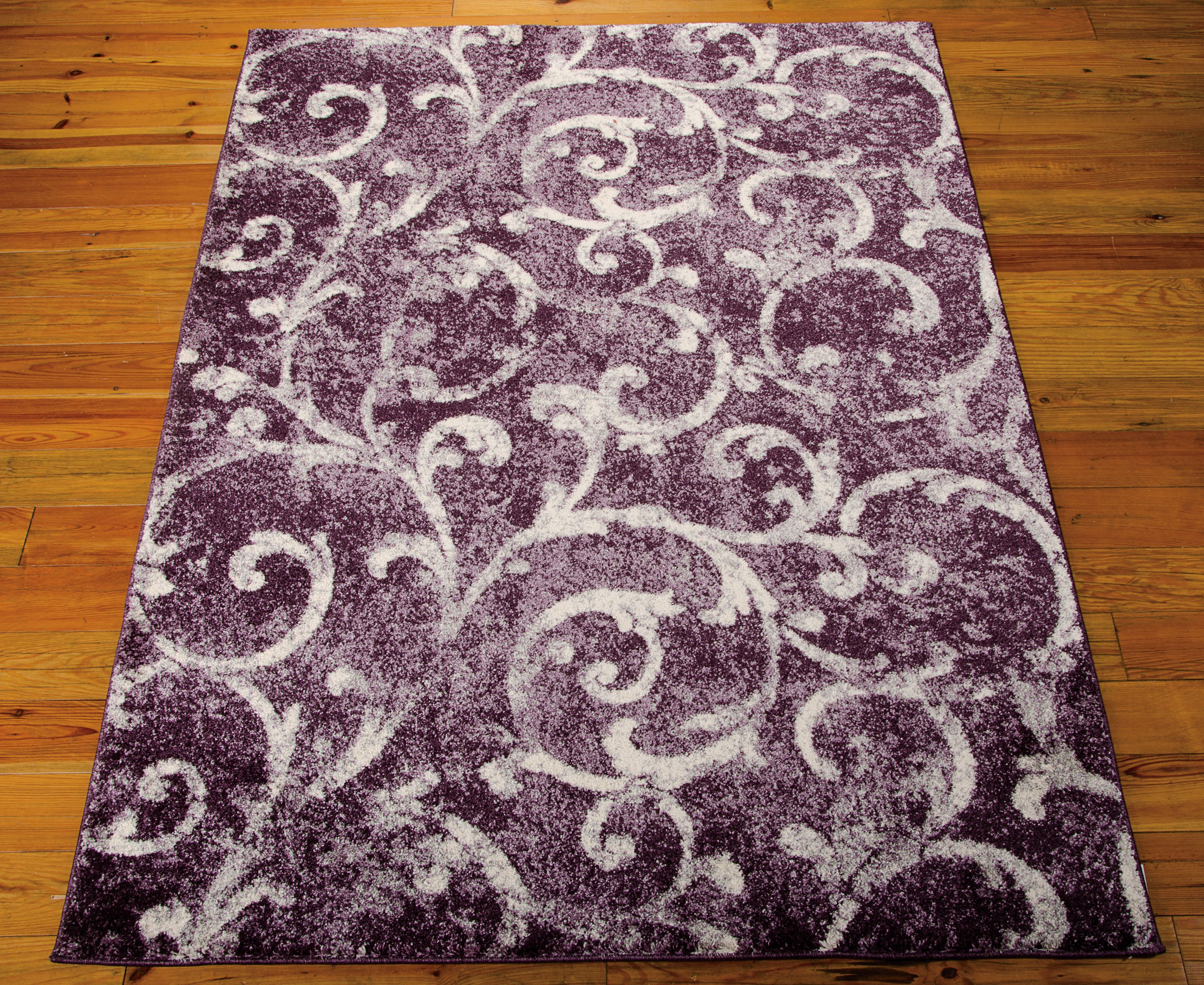From the Kathy Ireland Home Santa Barbara Collection, the El Pacico Dark Violet is trend-setting shag that instills a sense of ease, elegance and cozy intimacy.