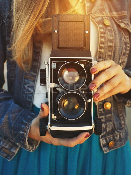 Summer lifestyle portrait of hipster girl with old camera stock photo (c)  vlad star ( f8d1cadf34f