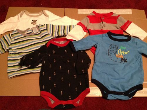 Auction for onesies and shirts too small for my son.  .99 cent start.
