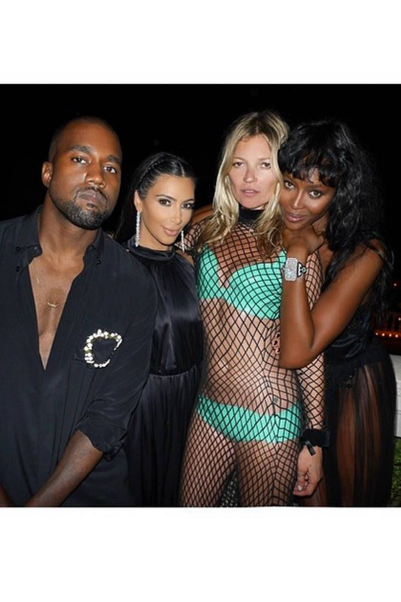 Kate Moss is not human. This bikini/fishnet number is proof.   - MarieClaire.com